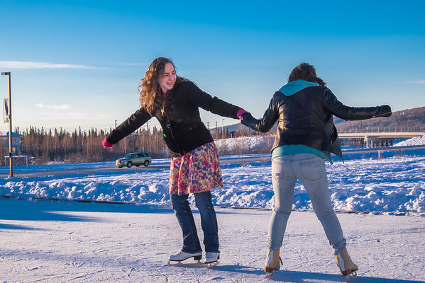"""Music majors Sarah Riopelle, left, and Rose Crelli find time between classes to have fun on the ice rink in front of the SRC on a sunny January afternoon.  <div class=""""ss-paypal-button"""">Filename: LIF-15-4428-73.jpg</div><div class=""""ss-paypal-button-end""""></div>"""