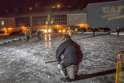 Outdoor broomball, played on the ice in front of the SRC, is a popular intramural sport at UAF.  Filename: LIF-12-3652-107.jpg