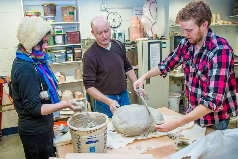 """Art major Ian Wilkinson covers a turkey in clay and strips of papier mache in the ceramics lab in the UAF Fine Arts complex. The process has been perfected over the past 20 years by Professor Jim Brashear, center, who hosts a feast each year for hungry students on campus over Thanksgiving break.  <div class=""""ss-paypal-button"""">Filename: LIF-12-3659-70.jpg</div><div class=""""ss-paypal-button-end"""" style=""""""""></div>"""