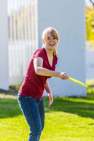 Music major Ingrid Dye takes time between classes to play with a frisbee on a beautiful September afternoon on the Fairbanks campus.  Filename: LIF-13-3934-41.jpg