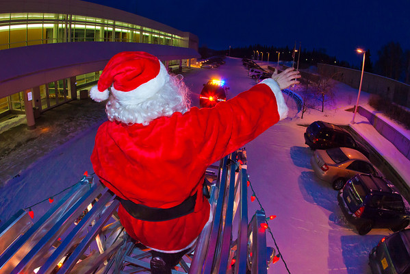 """Santa Claus made his annual rounds to various locations on the Fairbanks campus riding atop a University Fire Department truck a couple days before Christmas.  <div class=""""ss-paypal-button"""">Filename: LIF-11-3249-56.jpg</div><div class=""""ss-paypal-button-end"""" style=""""""""></div>"""