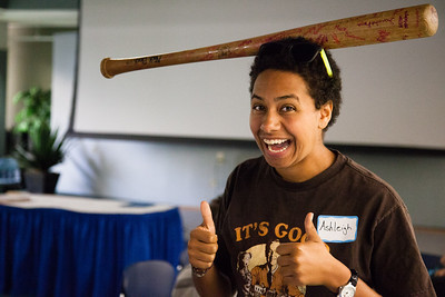 Ashleigh Strange balances a baseball bat while on break from resident assistant training before students attending the fall semester enter the residence halls Thursday, August 16, 2012 at the Hess Rec. Center. About forty RAs attended the training.  Filename: LIF-12-3498-69.jpg