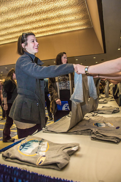 """University staff and faculty received free """"naturally inspiring"""" t-shirts following Chancellor Rogers 2012 convocation address.  <div class=""""ss-paypal-button"""">Filename: LIF-12-3545-83.jpg</div><div class=""""ss-paypal-button-end"""" style=""""""""></div>"""
