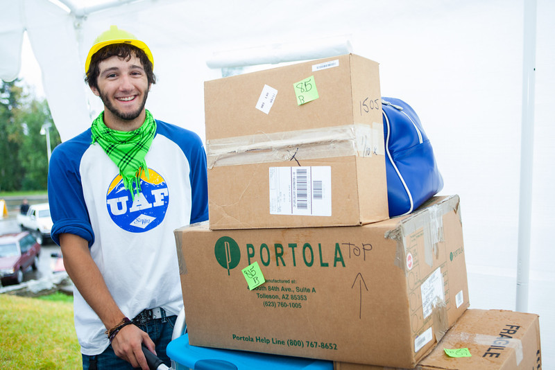 """Jordan Clark pauses for a photo before taking another load of personal belongings up to its designated dorm room during Move-In Day Sunday, August 26, 2012 in front of the Moore, Bartlett, and Skarland complex.  <div class=""""ss-paypal-button"""">Filename: LIF-12-3511-175.jpg</div><div class=""""ss-paypal-button-end"""" style=""""""""></div>"""