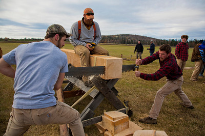 Jamie Hollingsworth (center) times students Ethan Stephens (left) and  Joe Hunner (right) participated in the 2011 Farthest North Forest Sports Festival hosted by the UAF School of Natural Resources & Agricultural Sciences.  Filename: LIF-11-3185-96.jpg