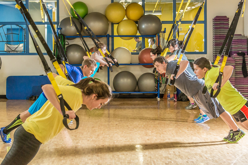 """Students work up a sweat during a fitness class on a Tuesday night in the Student Recreation Center.  <div class=""""ss-paypal-button"""">Filename: LIF-14-4111-19.jpg</div><div class=""""ss-paypal-button-end""""></div>"""