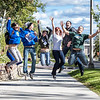 "New students on campus jump for a photograph on their way to the MBS complex Tuesday afternoon, August 28, 2012.  <div class=""ss-paypal-button"">Filename: LIF-12-3518-60.jpg</div><div class=""ss-paypal-button-end"" style=""""></div>"