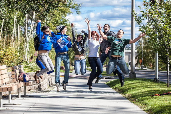 """New students on campus jump for a photograph on their way to the MBS complex Tuesday afternoon, August 28, 2012.  <div class=""""ss-paypal-button"""">Filename: LIF-12-3518-60.jpg</div><div class=""""ss-paypal-button-end"""" style=""""""""></div>"""