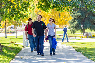 Jacob Monagle and Lindy Olmstead walk up the hill after lunch in the Commons on a beautiful September afternoon on the Fairbanks campus. Monagle is a senior majoring in electrical engineering. Olmstead is studying to become a nurse.  Filename: LIF-13-3934-129.jpg