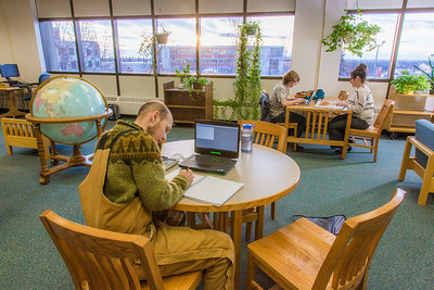Students take advantage of the quiet area on the 5th floor of the Rasmuson Library to catch up on some studying on a recent afternoon.  Filename: LIF-14-4045-49.jpg