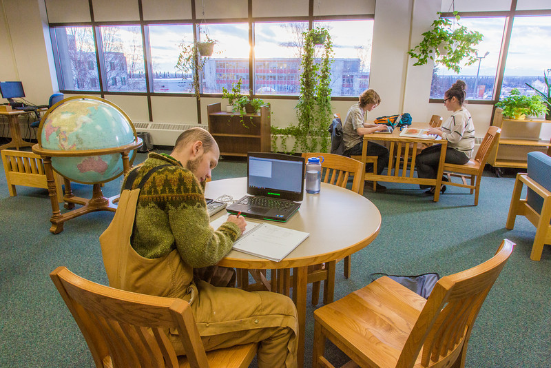 """Students take advantage of the quiet area on the 5th floor of the Rasmuson Library to catch up on some studying on a recent afternoon.  <div class=""""ss-paypal-button"""">Filename: LIF-14-4045-49.jpg</div><div class=""""ss-paypal-button-end"""" style=""""""""></div>"""