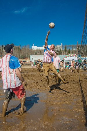 """Participants in UAF's SpringFest activities get down and dirty in the mud volleyball games on the Fairbanks campus.  <div class=""""ss-paypal-button"""">Filename: LIF-12-3376-86.jpg</div><div class=""""ss-paypal-button-end"""" style=""""""""></div>"""