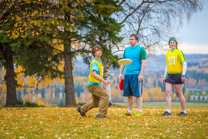 "Students warm up for a bout of utlimate frisbee in the field near the University of Alaska's Museum of the North on a fall afternoon.  <div class=""ss-paypal-button"">Filename: LIF-12-3557-074.jpg</div><div class=""ss-paypal-button-end"" style=""""></div>"