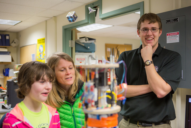 """Wyatt Rehder, right, shows the insides of a rocket to children and their parents during the E-Week open house in the Duckering Building.  <div class=""""ss-paypal-button"""">Filename: LIF-13-3741-3.jpg</div><div class=""""ss-paypal-button-end"""" style=""""""""></div>"""