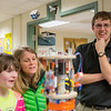 "Wyatt Rehder, right, shows the insides of a rocket to children and their parents during the E-Week open house in the Duckering Building.  <div class=""ss-paypal-button"">Filename: LIF-13-3741-3.jpg</div><div class=""ss-paypal-button-end"" style=""""></div>"