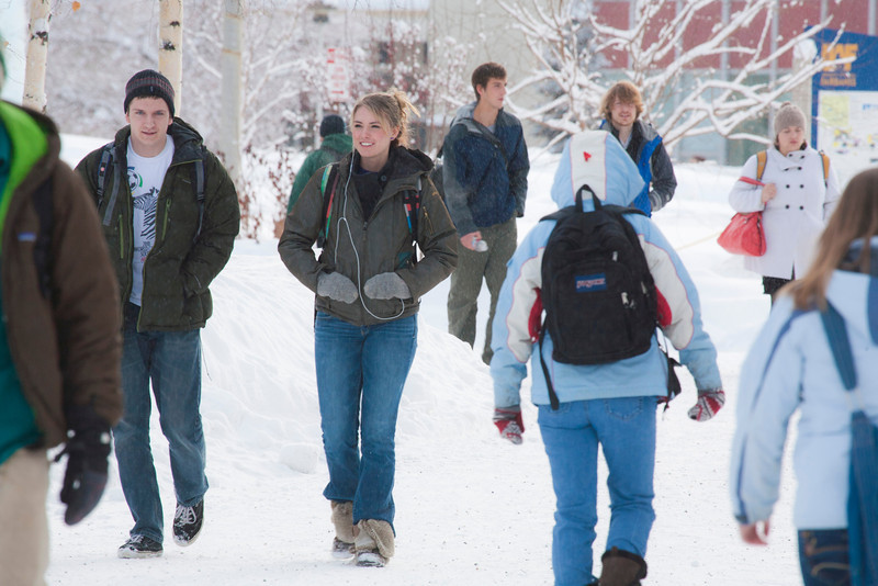 """Jaxon Hill (center) walks with Corey Day (left)  across campus between classes.  <div class=""""ss-paypal-button"""">Filename: LIF-12-3319-49.jpg</div><div class=""""ss-paypal-button-end"""" style=""""""""></div>"""