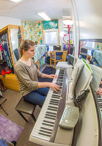 Music major Kaylie Wiltersen practices the keyboard in her Skarland Hall single room.  Filename: LIF-13-3735-79.jpg