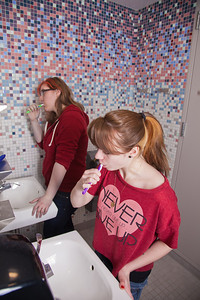 Skarland Hall residents Mary-Clare Cable, left, and Hailley Myers get ready for a day of classes in one of the newly re-modeled bathrooms.  Filename: LIF-12-3322-102.jpg