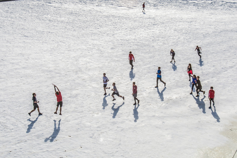 "Students play some ultimate frisbee on the snow-covered field by the SRC on an April afternoon.  <div class=""ss-paypal-button"">Filename: LIF-14-4132-8.jpg</div><div class=""ss-paypal-button-end"" style=""""></div>"