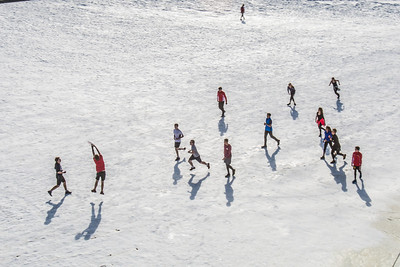 Students play some ultimate frisbee on the snow-covered field by the SRC on an April afternoon.  Filename: LIF-14-4132-8.jpg
