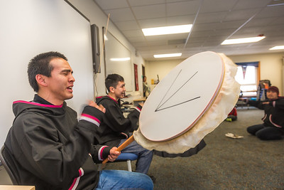 Justin Bill, left, and Chase Alexie beat the drums for the KuC Yuraq Dance Group as they practice in the school's conference room on March 30, 2016 in preparation for their upcoming appearance at the Cama-i Dance Festival in Bethel.  Filename: LIF-16-4859-431.jpg