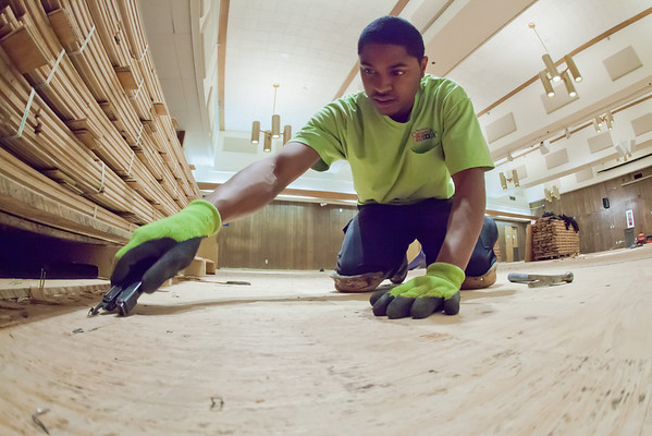 """Steven James with MacChayne's Carpet Plus prepares the subfloor in the Wood Center Ballroom before installation of a new floor.  <div class=""""ss-paypal-button"""">Filename: LIF-11-3244-25.jpg</div><div class=""""ss-paypal-button-end"""" style=""""""""></div>"""