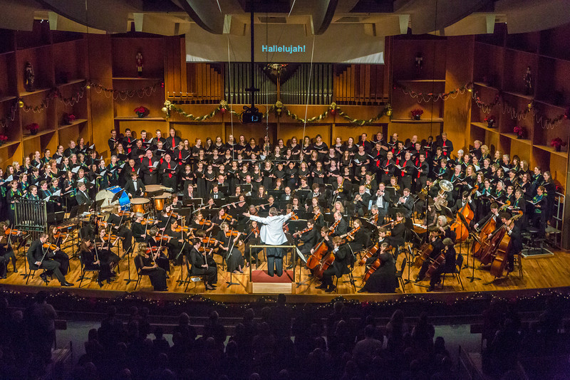 """Eduard Zilberkant conducts the Fairbanks Symphony Orchestra along with the Fairbanks Symphony Chorus and the Northland Youth Choir during the annual holiday concert in the Davis Concert Hall.  <div class=""""ss-paypal-button"""">Filename: LIF-13-4016-185.jpg</div><div class=""""ss-paypal-button-end"""" style=""""""""></div>"""