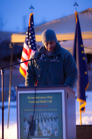 """UAF ROTC cadet Raye Diamond takes an early 15-minute shift reading names of American service men and women killed during the wars in Iraq and Afghanistan during a Veterans' Day memorial ceremony in Constitution Park.  <div class=""""ss-paypal-button"""">Filename: LIF-11-3216-30.jpg</div><div class=""""ss-paypal-button-end"""" style=""""""""></div>"""
