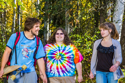 Demetri Martin-Urban, left, Grace Amundsen, center, and Kaylie Wiltersen stroll through the woods near the west entrance to campus on a nice fall afternoon.  Filename: LIF-12-3544-147.jpg