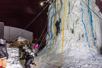 A climber makes hiw way up the tower during the ice climbing competition, offered as part of the 2014 UAF Winter Carnival.  Filename: LIF-14-4084-61.jpg