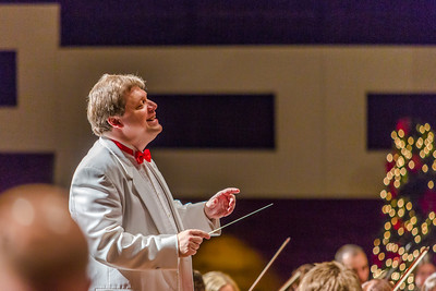 Eduard Zilberkant conducts the Fairbanks Symphony Orchestra along with the Fairbanks Symphony Chorus and the Northland Youth Choir during the annual holiday concert in the Davis Concert Hall.  Filename: LIF-13-4016-147.jpg