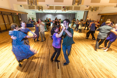 Members of the Fairbanks community joined UAF students and staff for a Contra Dance in the Wood Center Ballroom as part of the 2014 Winter Carnival on campus.  Filename: LIF-14-4085-26.jpg