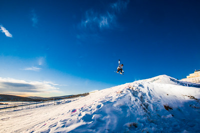 Students enjoy some of the features of UAF's terrain park on a spring afternoon.  Filename: LIF-13-3746-34.jpg