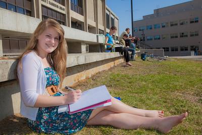 UAF student Kaylee Miltersen works on her homework in the April sunshine outside the library.  Filename: LIF-12-3356-81.jpg