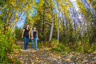 Lily Grbavach, left, and Kaylie Wiltersen, stroll through the woods near the west entrance to campus on a nice fall afternoon.  Filename: LIF-12-3544-096.jpg