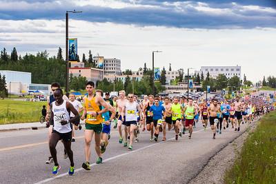 Thousands of participants in the 2016 Midnight Sun Run start the 10-kilometer race on lower campus' Tanana Loop, Saturday, June 18, 2016.  Filename: LIF-16-4918-102.jpg