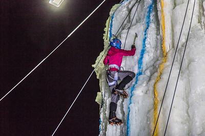 A climber approaches the top of the tower during the ice climbing competition, offered as part of the 2014 UAF Winter Carnival.  Filename: LIF-14-4084-75.jpg