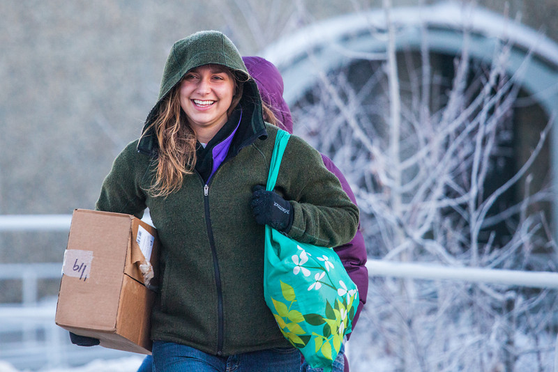 """Lauren Bell heads to the bus shelter to wait for the campus shuttle on a cold December day on campus.  <div class=""""ss-paypal-button"""">Filename: LIF-12-3664-18.jpg</div><div class=""""ss-paypal-button-end"""" style=""""""""></div>"""