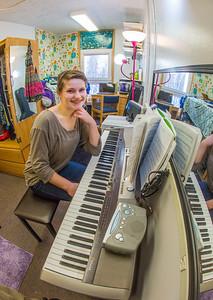 Music major Kaylie Wiltersen practices on her keyboard in her Skarland Hall single room.  Filename: LIF-13-3735-85.jpg