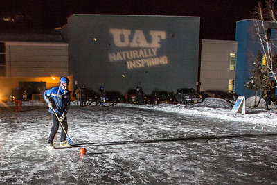 Students warm up before an intramural broomball match on the ice in front of the SRC.  Filename: LIF-12-3652-16.jpg