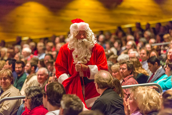 """Santa Claus makes an appearance during the Fairbanks Symphony's annual holiday concert in the Davis Concert Hall.  <div class=""""ss-paypal-button"""">Filename: LIF-13-4016-70.jpg</div><div class=""""ss-paypal-button-end"""" style=""""""""></div>"""