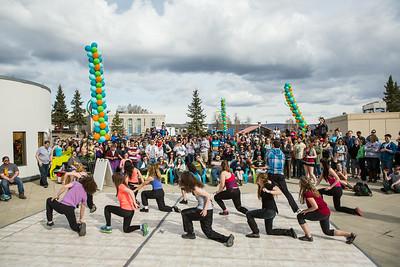 Students dance on a makeshift dancefloor on the Wood Center deck during Spring Fest.  Filename: LIF-14-4161-9.jpg