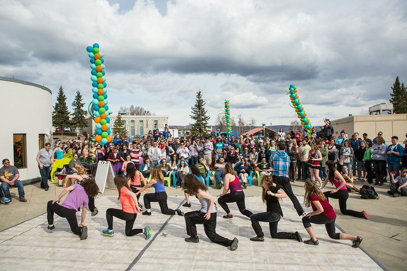 """Students dance on a makeshift dancefloor on the Wood Center deck during Spring Fest.  <div class=""""ss-paypal-button"""">Filename: LIF-14-4161-9.jpg</div><div class=""""ss-paypal-button-end""""></div>"""