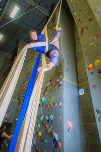 Graduate student Stephany Jeffers practices her silk climbing skills in the SRC.  Filename: LIF-13-3819-11.jpg