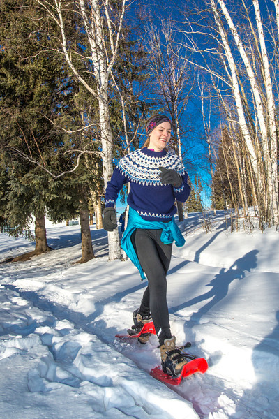 """One of the participants in the second annual Troth Yeddha' Park Snowshoe Scramble makes her way towards the home stretch  Saturday, March 1 to help raise awareness for the proposed park to help celebrate Alaska's Native culture.  <div class=""""ss-paypal-button"""">Filename: LIF-14-4079-62.jpg</div><div class=""""ss-paypal-button-end"""" style=""""""""></div>"""