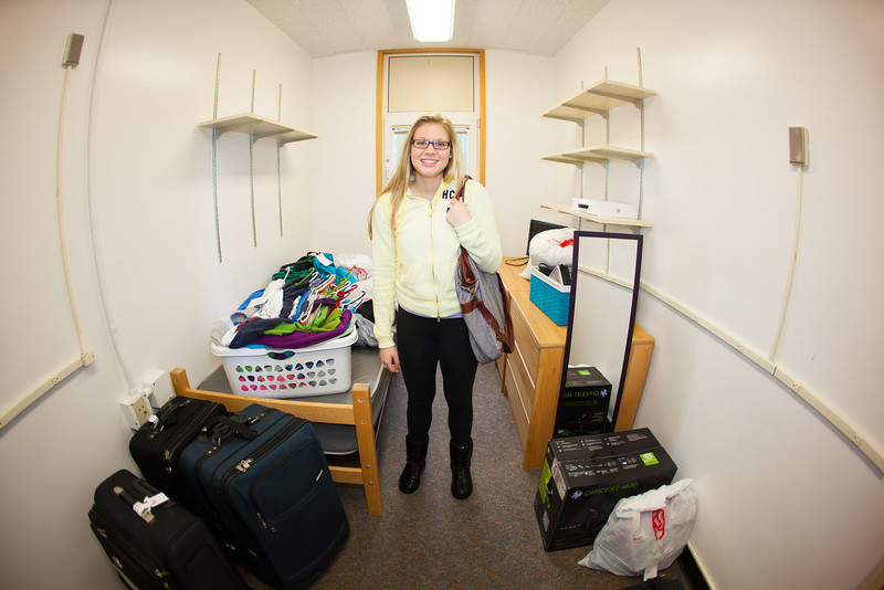 "Sheridan Culver pauses for a photo after lugging her personal belongings with two Orientation Leaders up to her single Moore dorm room Sunday, August 26, 2012.  <div class=""ss-paypal-button"">Filename: LIF-12-3511-41.jpg</div><div class=""ss-paypal-button-end"" style=""""></div>"