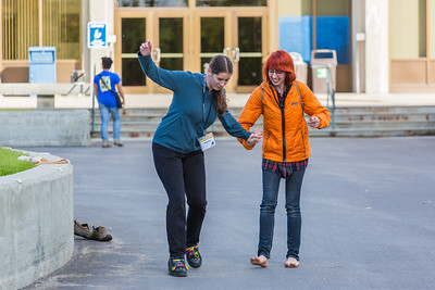 Freshman Montana Troyer, left, gets a lesson in shoe skating during Orientation Week on the Fairbanks campus at the start of the fall 2015 semester.  Filename: LIF-15-4638-036.jpg