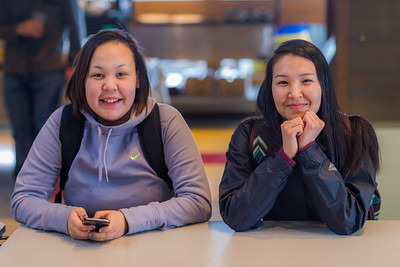 Wilona Okitkun from Kotlik, left, and Larissa Flynn from Chefornak relax after class in the Sacket Hall dining room on UAF's Kuskokwim Campus in Bethel.  Filename: LIF-16-4859-030.jpg