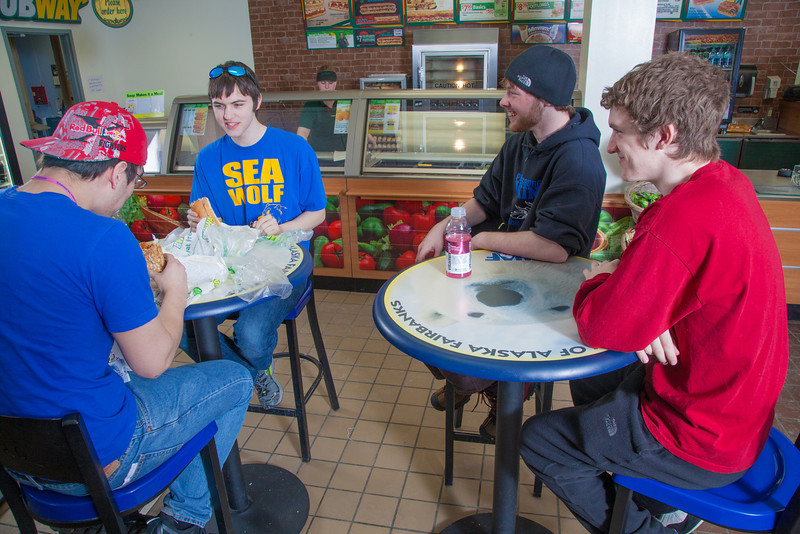 """Students Robert Doerning, left, and Quinn Verfaillie, left, and  enjoy sandwiches in the Campus Cache, located in the Moore-Bartlett-Skarland residence hall complex on the Fairbanks campus.  <div class=""""ss-paypal-button"""">Filename: LIF-12-3339-55.jpg</div><div class=""""ss-paypal-button-end"""" style=""""""""></div>"""