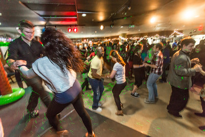 Students learn some new steps during a Latin Dance evening in the Wood Center Pub, one of many events in the 2014 UAF Winter Carnival.  Filename: LIF-14-4086-14.jpg